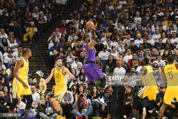 LeBron James of the Los Angeles Lakers shoots the ball against the Golden State Warriors on December 25 2018 at ORACLE Arena in Oakland California...