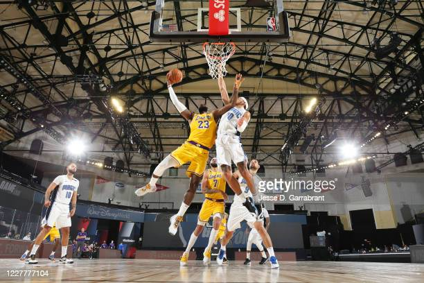 LeBron James of the Los Angeles Lakers shoots the ball against the Orlando Magic during a scrimmage on July 25, 2020 at HP Field House at ESPN Wide...