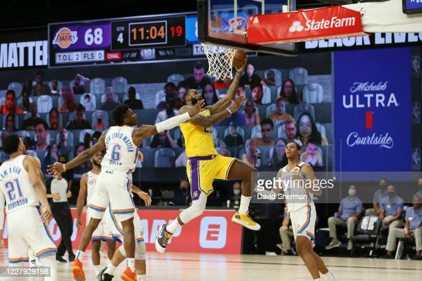LeBron James of the Los Angeles Lakers shoots the ball against the Oklahoma City Thunder on August 5, 2020 at The Arena at ESPN Wide World of Sports...