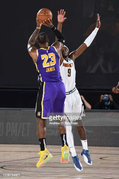 LeBron James of the Los Angeles Lakers shoots the ball against the Denver Nuggets during Game Five of the Western Conference Finals on September 26...
