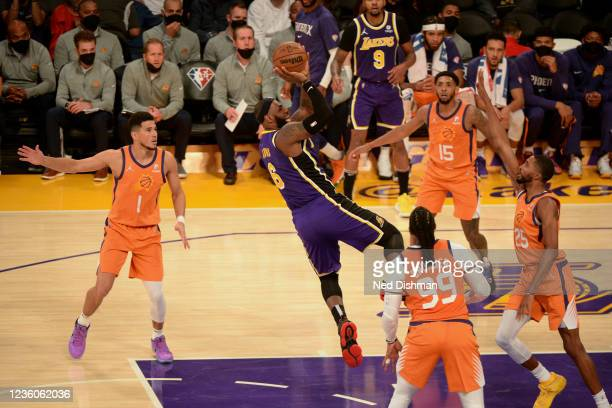 LeBron James of the Los Angeles Lakers shoots the ball against the Phoenix Suns on October 22, 2021 at STAPLES Center in Los Angeles, California....
