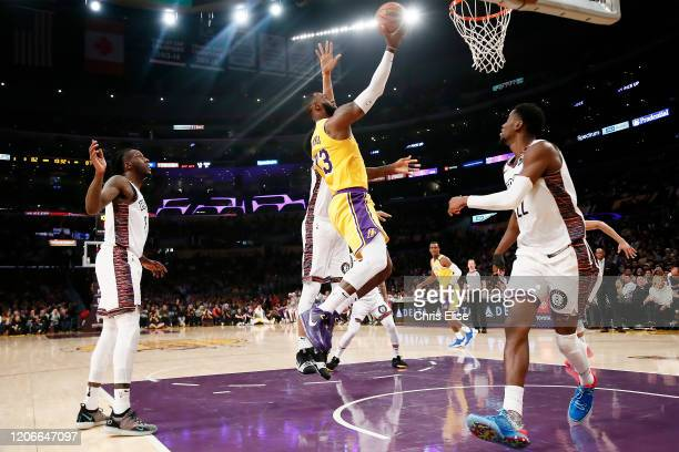 LeBron James of the Los Angeles Lakers shoots the ball during a game against the Brooklyn Nets at the Staples Center on March 10 2020 in Los Angeles...