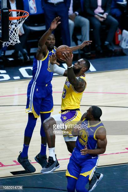 LeBron James of the Los Angeles Lakers shoots the ball during the game against the Golden State Warriors on October 10 2018 at TMobile Arena in Las...