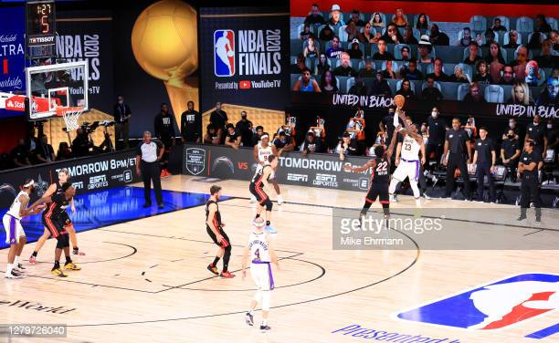 LeBron James of the Los Angeles Lakers shoots the ball over Jimmy Butler of the Miami Heat during the fourth quarter in Game Six of the 2020 NBA...