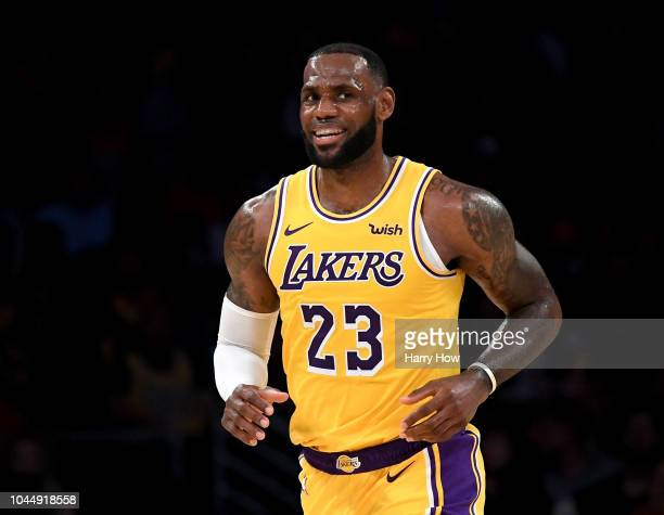 LeBron James of the Los Angeles Lakers smiles during a preseason game against the Denver Nuggets at Staples Center on October 2 2018 in Los Angeles...