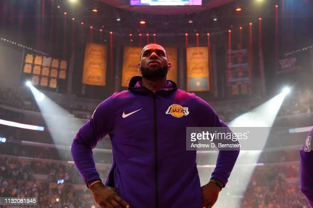 LeBron James of the Los Angeles Lakers stands for the National Anthem prior to a game against the Brooklyn Nets on March 22 2019 at STAPLES Center in...