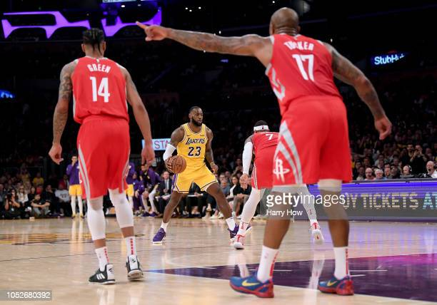 LeBron James of the Los Angeles Lakers starts a play in front of Carmelo Anthony Gerald Green and PJ Tucker of the Houston Rockets during a 124115...