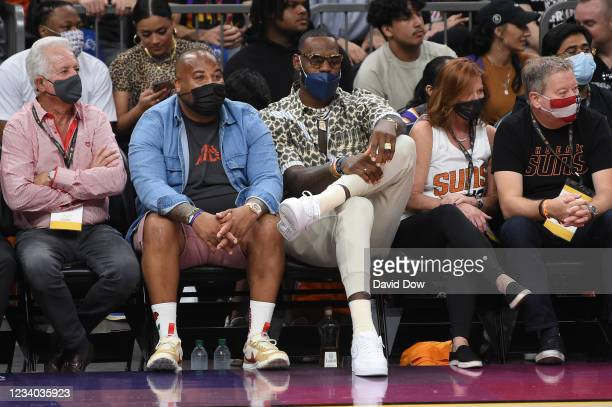 LeBron James of the Los Angeles Lakers takes in the game of the Milwaukee Bucks against the Phoenix Suns during Game Five of the 2021 NBA Finals on...
