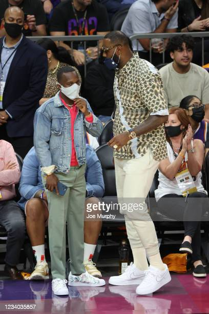 July 17: LeBron James of the Los Angeles Lakers talks to his agent Rich Paul during the Milwaukee Bucks game against the Phoenix Suns during Game...