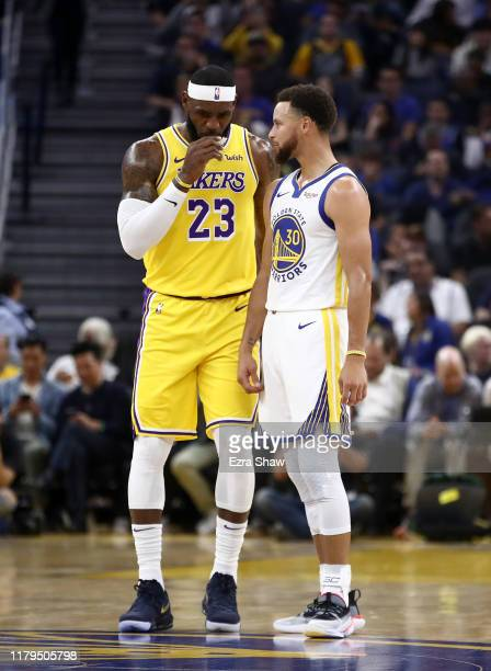 LeBron James of the Los Angeles Lakers talks to Stephen Curry of the Golden State Warriors during their game at Chase Center on October 05 2019 in...
