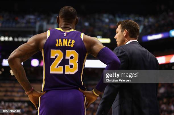 LeBron James of the Los Angeles Lakers talks with head coach Luke Walton during the NBA game against the Phoenix Suns at Talking Stick Resort Arena...