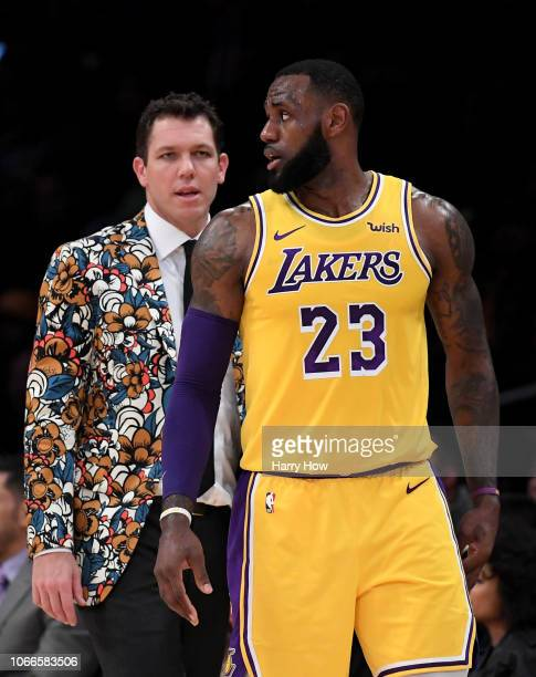LeBron James of the Los Angeles Lakers talks with Luke Walton during the first half against the Indiana Pacers at Staples Center on November 29 2018...