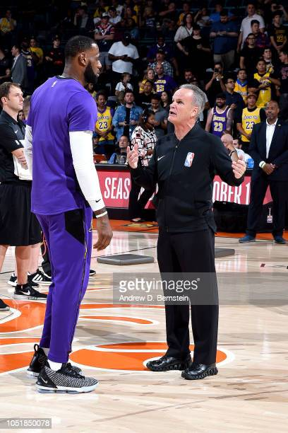 LeBron James of the Los Angeles Lakers talks with Referee Mike Callahan against the Denver Nuggets during a preseason game on September 30 2018 at...