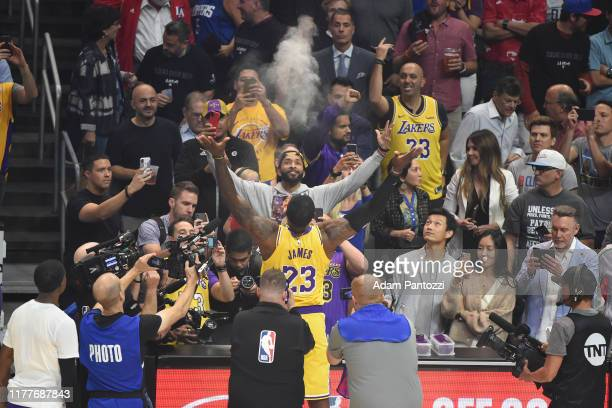 LeBron James of the Los Angeles Lakers throws up chalk before the game against the LA Clippers on October 22 2019 at STAPLES Center in Los Angeles...
