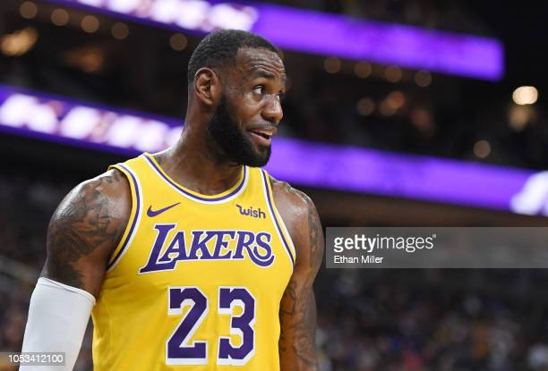 LeBron James of the Los Angeles Lakers walks on the court during a stop in play in a preseason game against the Golden State Warriors at TMobile...