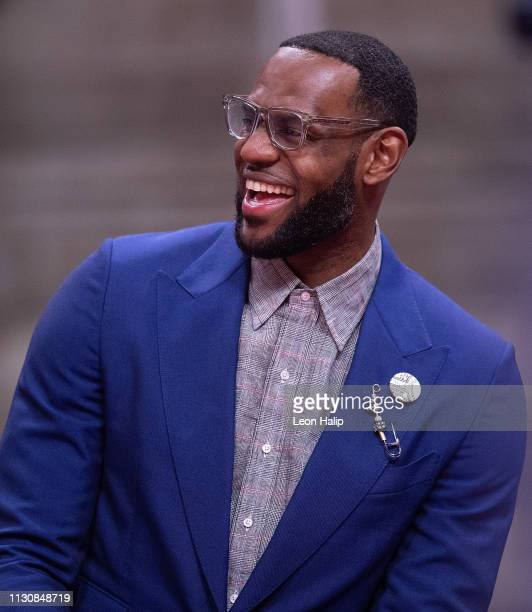LeBron James of the Los Angeles Lakers watches the game from the sidelines during the third quarter against the Detroit Pistons at Little Caesars...