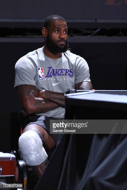LeBron James of the Los Angeles Lakers watches the game from the sidelines during the game on August 13 2020 at The Field House in Orlando Florida...