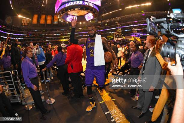 LeBron James of the Los Angeles Lakers waves to fans as he walks off the court after the game against the Portland Trail Blazers on November 14 2018...