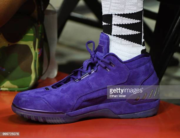 LeBron James of the Los Angeles Lakers wears purple suede Nike Air Zoom Generation sneakers as he attends a quarterfinal game of the 2018 NBA Summer...