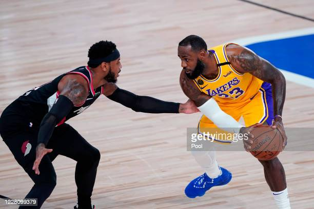 LeBron James of the Los Angeles Lakers works the ball against Carmelo Anthony of the Portland Trail Blazers during the first half in Game 1 of Round...