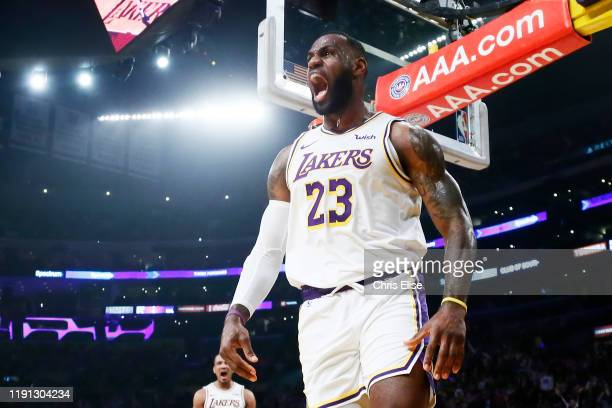 LeBron James of the Los Angeles Lakers yells and celebrates after a dunk against the Phoenix Suns on January 1 2020 at STAPLES Center in Los Angeles...