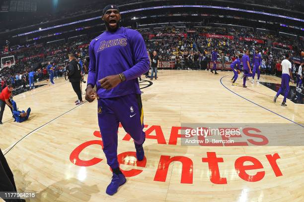 LeBron James of the Los Angeles Lakers yells and warms up before the game against the LA Clippers on October 22 2019 at STAPLES Center in Los Angeles...