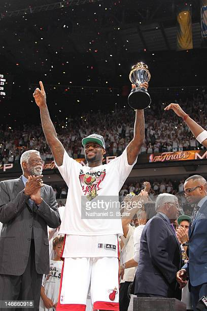 LeBron James of the Miami Heat accepts the Bill Russell NBA Finals Most Valuable Player Award after defeating the Oklahoma City Thunder in Game Five...