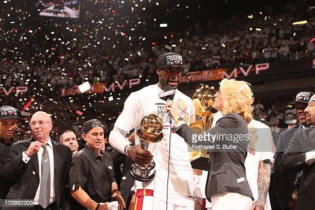 LeBron James of the Miami Heat accepts the Bill Russell NBA Finals Most Valuable Player Award after the Miami Heat defeat the San Antonio Spurs in...