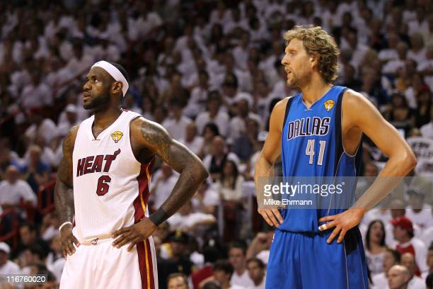 LeBron James of the Miami Heat and Dirk Nowitzki of the Dallas Mavericks look on in Game Six of the 2011 NBA Finals at American Airlines Arena on...