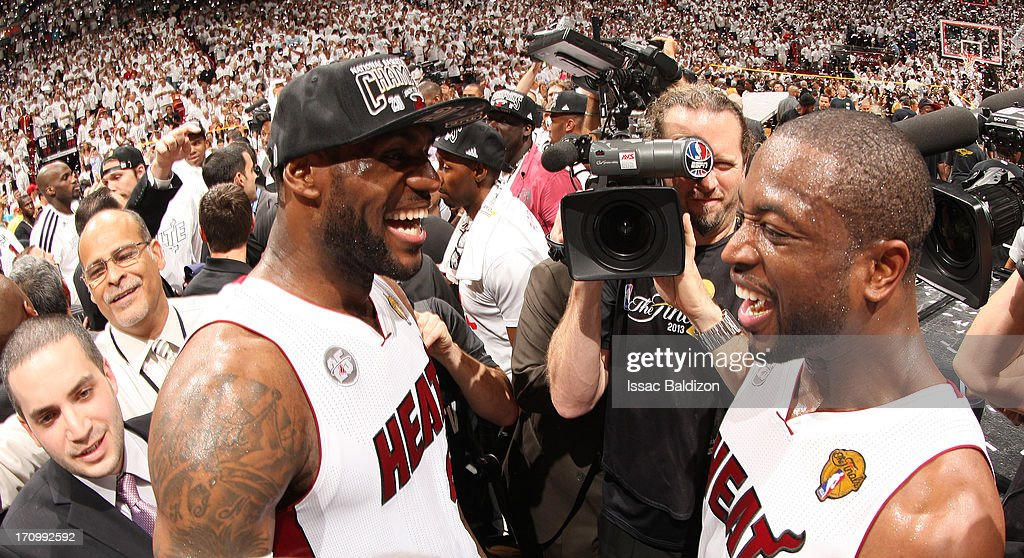 LeBron James #6 of the Miami Heat and Dwyane Wade #3 of the Miami Heat congratulate each other with their championship victory in Game Seven of the 2013 NBA Finals between the San Antonio Spurs and the Miami Heat on June 20, 2013 at American Airlines Arena in Miami, Florida.