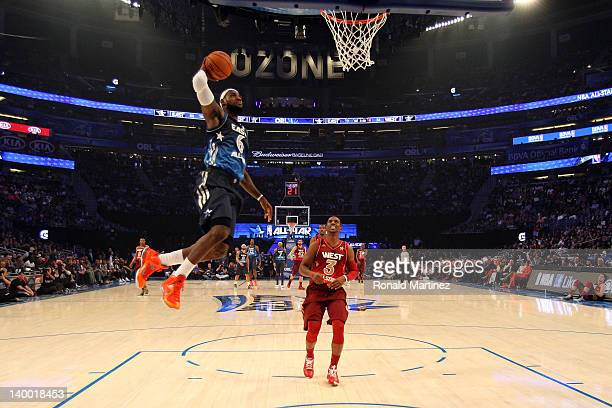 LeBron James of the Miami Heat and the Eastern Conference drives for a dunk attempt against Chris Paul of the Los Angeles Clippers and the Western...