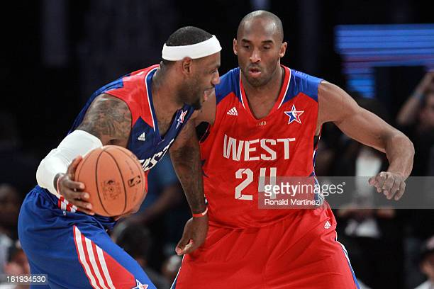 LeBron James of the Miami Heat and the Eastern Conference drives on Kobe Bryant of the Los Angeles Lakers and the Western Conference in the second...