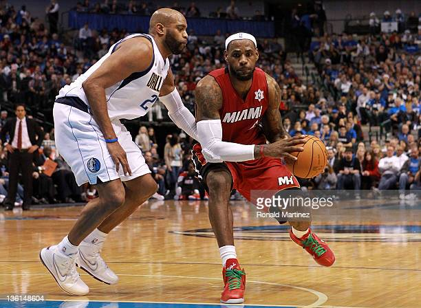 LeBron James of the Miami Heat and Vince Carter of the Dallas Mavericks at American Airlines Center on December 25 2011 in Dallas Texas