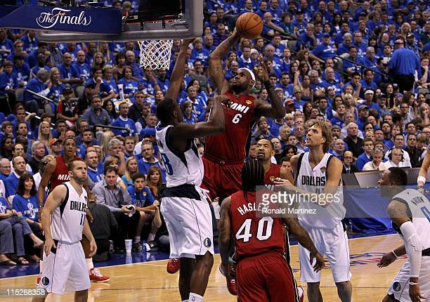 LeBron James of the Miami Heat attempts a dunk in the first half against Ian Mahinmi of the Dallas Mavericks in Game Three of the 2011 NBA Finals at...
