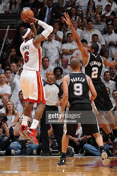 LeBron James of the Miami Heat attempts a shot against Kawhi Leonard of the San Antonio Spurs during Game Seven of the 2013 NBA Finals on June 20...