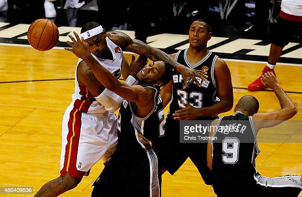 LeBron James of the Miami Heat battles against Kawhi Leonard of the San Antonio Spurs for a rebound during Game Three of the 2014 NBA Finals at...
