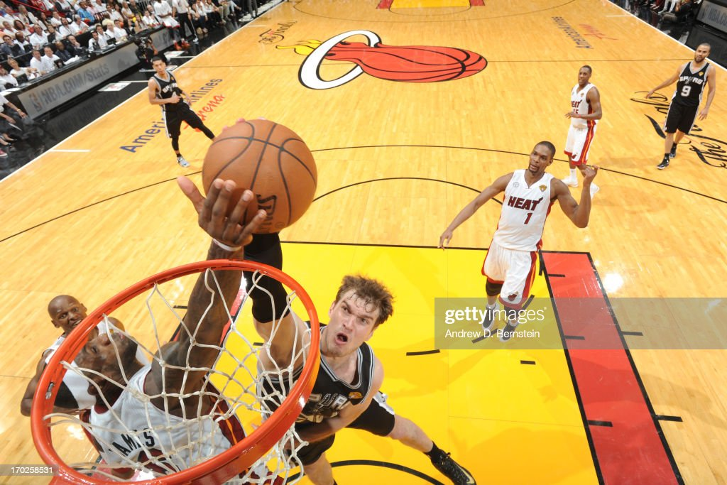 LeBron James #6 of the Miami Heat blocks a dunk against Tiago Splitter #22 of the San Antonio Spurs during Game Two of the 2013 NBA Finals on June 9, 2013 at American Airlines Arena in Miami, Florida.
