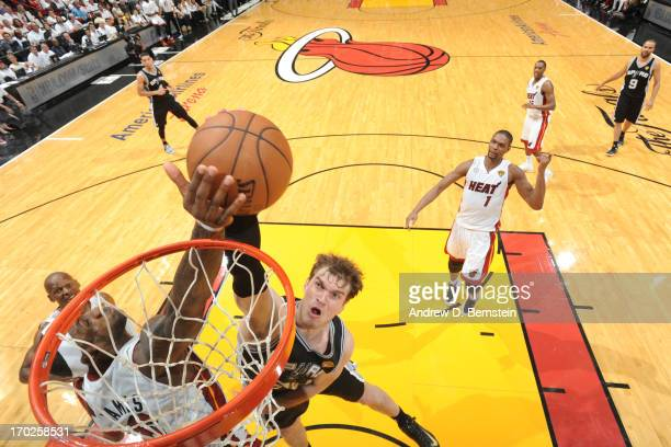 LeBron James of the Miami Heat blocks a dunk against Tiago Splitter of the San Antonio Spurs during Game Two of the 2013 NBA Finals on June 9 2013 at...