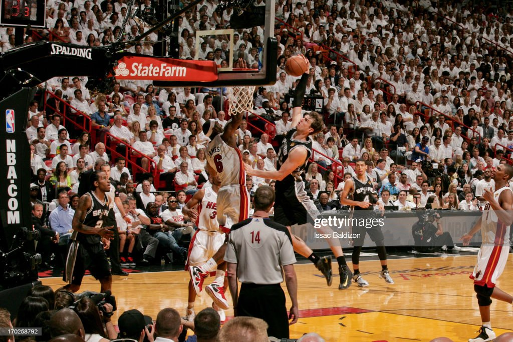 LeBron James #6 of the Miami Heat blocks a dunk attempt by Tiago Splitter #22 of the San Antonio Spurs during Game Two of the 2013 NBA Finals on June 9, 2013 at American Airlines Arena in Miami, Florida.
