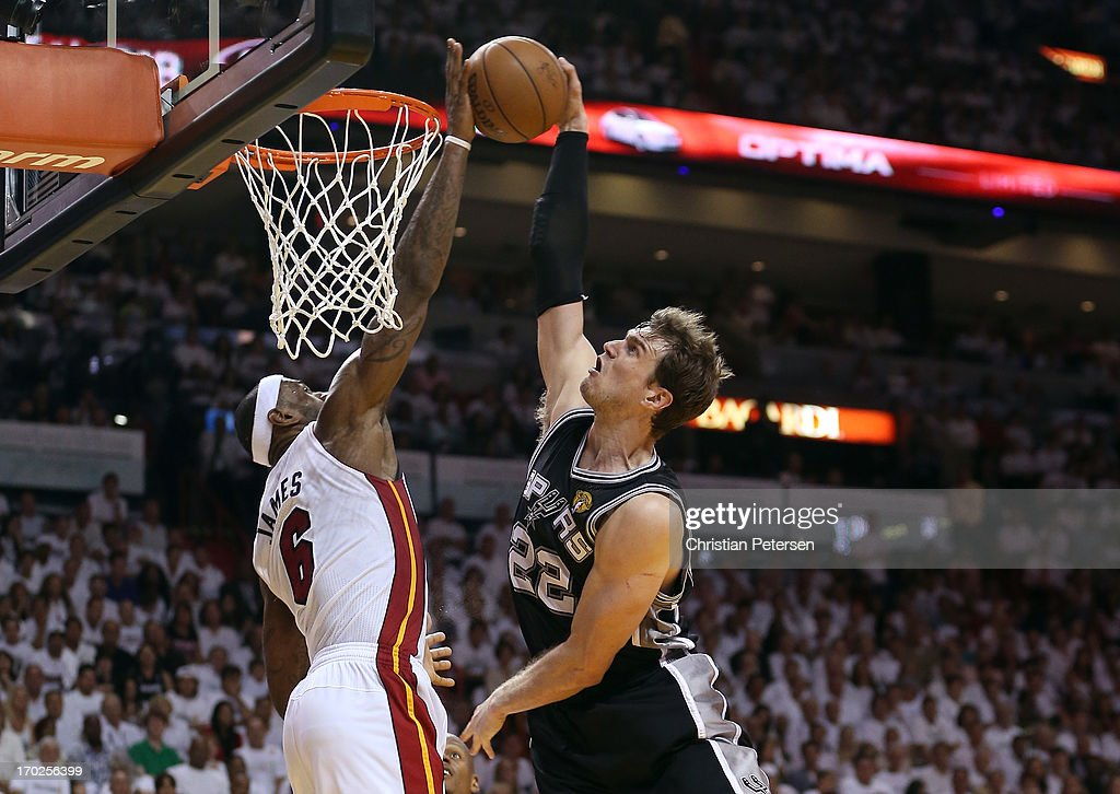 LeBron James #6 of the Miami Heat blocks the shot of Tiago Splitter #22 of the San Antonio Spurs in the fourth quarter during Game Two of the 2013 NBA Finals at AmericanAirlines Arena on June 9, 2013 in Miami, Florida.