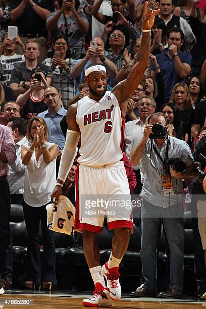 LeBron James of the Miami Heat celebrates after scoring a career high 61 points against the Charlotte Bobcats at the American Airlines Arena in Miami...