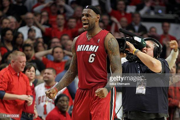 LeBron James of the Miami Heat celebrates after the Heat won 83-80 against the Chicago Bulls in Game Five of the Eastern Conference Finals during the...