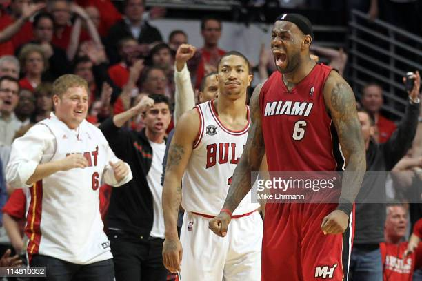 LeBron James of the Miami Heat celebrates after the Heat won 8380 against Derrick Rose of the Chicago Bulls in Game Five of the Eastern Conference...