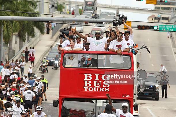 LeBron James of the Miami Heat celebrates during the championship celebration parade through downtown on June 24 2013 in Miami Florida The Miami Heat...