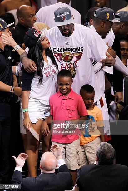 LeBron James of the Miami Heat celebrates his wife Savannah Brinson and family after they Heat won 121106 against the Oklahoma City Thunder in Game...