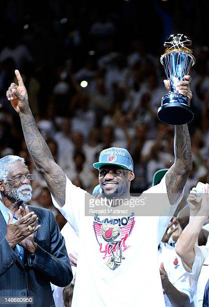 LeBron James of the Miami Heat celebrates with the Bill Russell Finals MVP trophy after they won 121-106 against the Oklahoma City Thunder in Game...