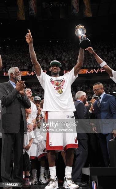 LeBron James of the Miami Heat celebrates with the Bill Russell NBA Finals Most Valuable Player Award after the team's 121106 victory against the...