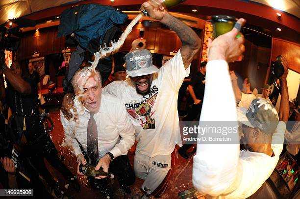 LeBron James of the Miami Heat celerates with Miami Heat team President Pat Riley in a locker room after winning Game Five of the 2012 NBA Finals...