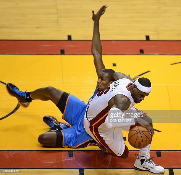 LeBron James of the Miami Heat collides with Serge Ibaka of the Oklahoma City Thunder during Game 3 of the NBA Finals on June 17 2012 at the American...