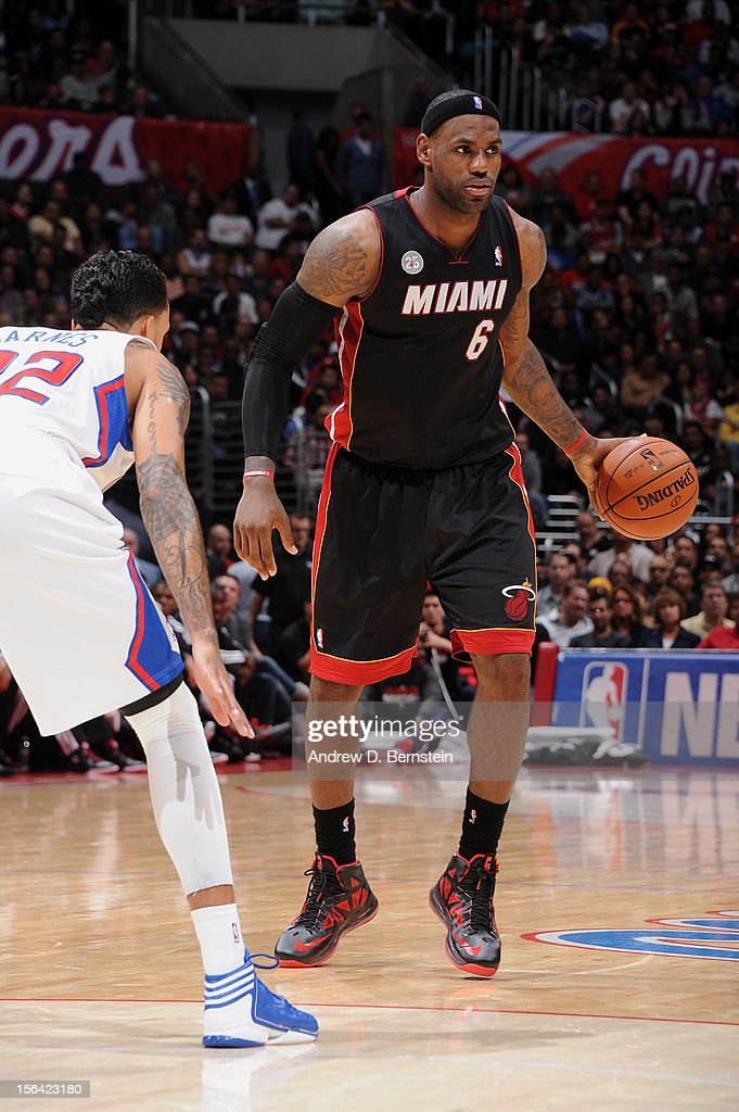 LeBron James #6 of the Miami Heat controls the ball against Matt Barnes #22 of the Los Angeles Clippers at the Staples Center on November 14, 2012 in Los Angeles, California.